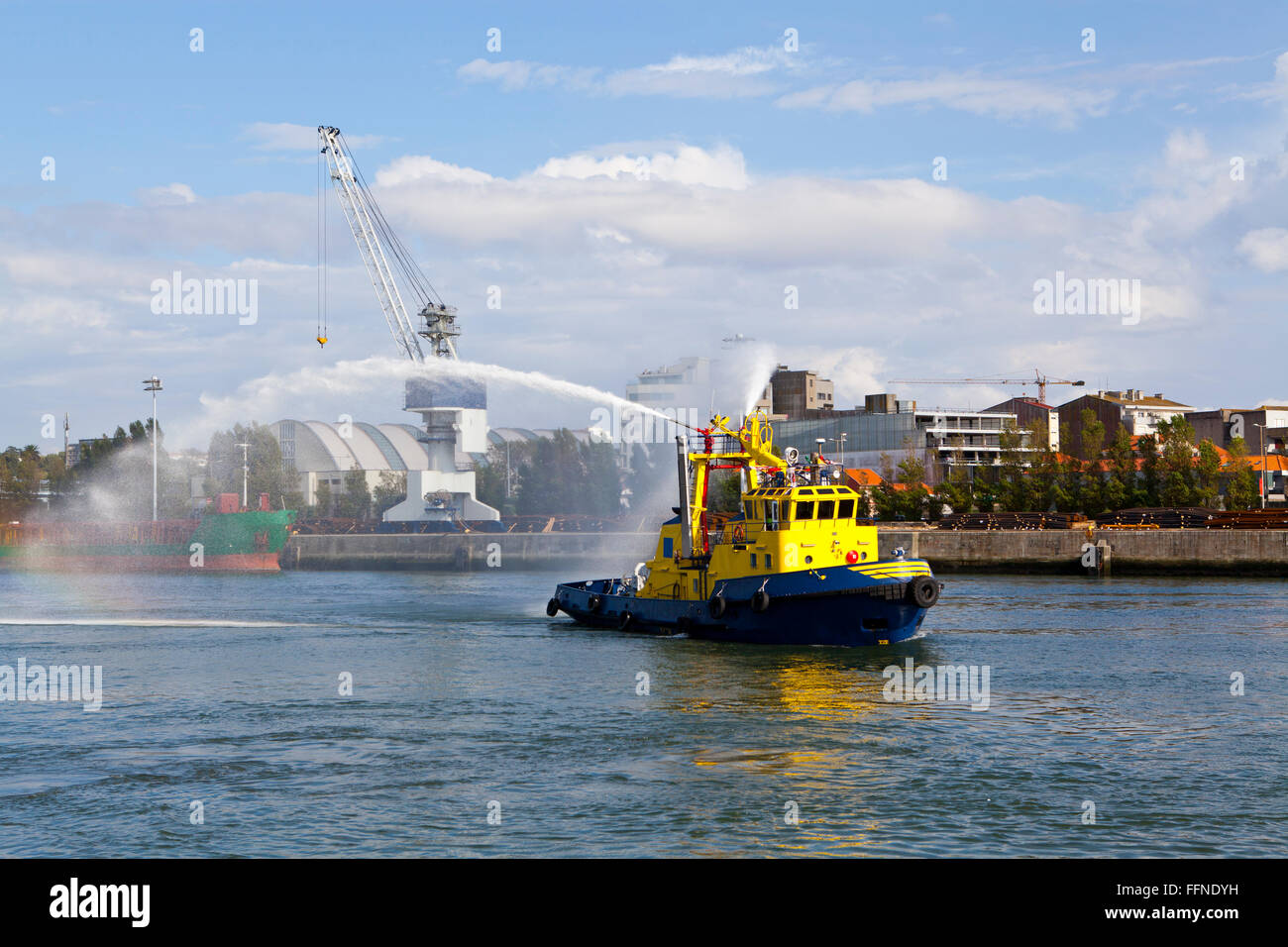Commercial Dock with a Tugboat - Stock Image
