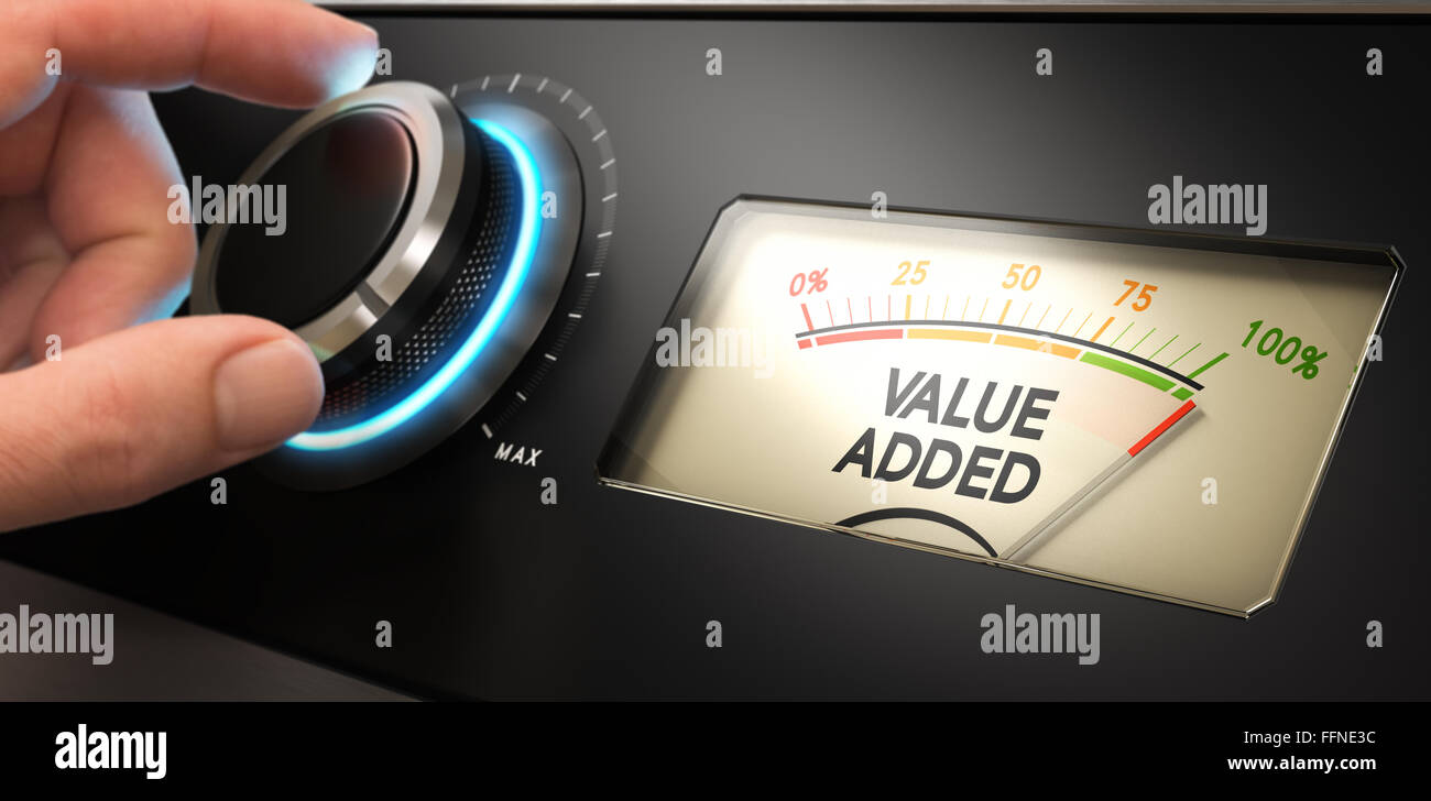 Hand turning a knob up to the maximum with a dial where it is written the text value added. Concept image for illustration - Stock Image