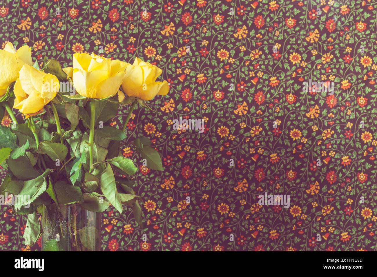 Detail of yellow roses against a brown vintage background - Stock Image