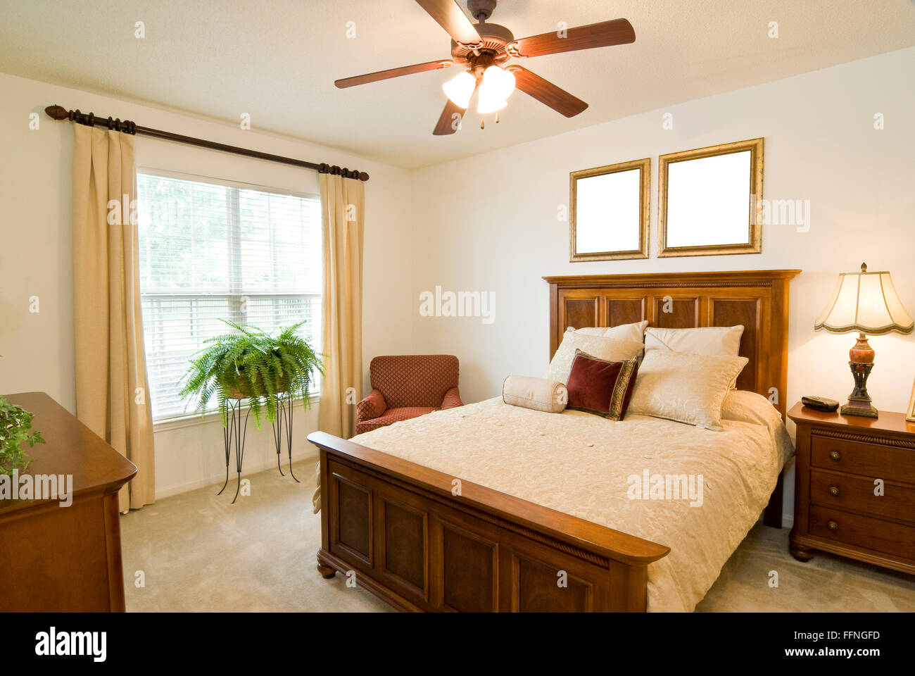 Two Blank Picture Frames In Bedroom - Stock Image