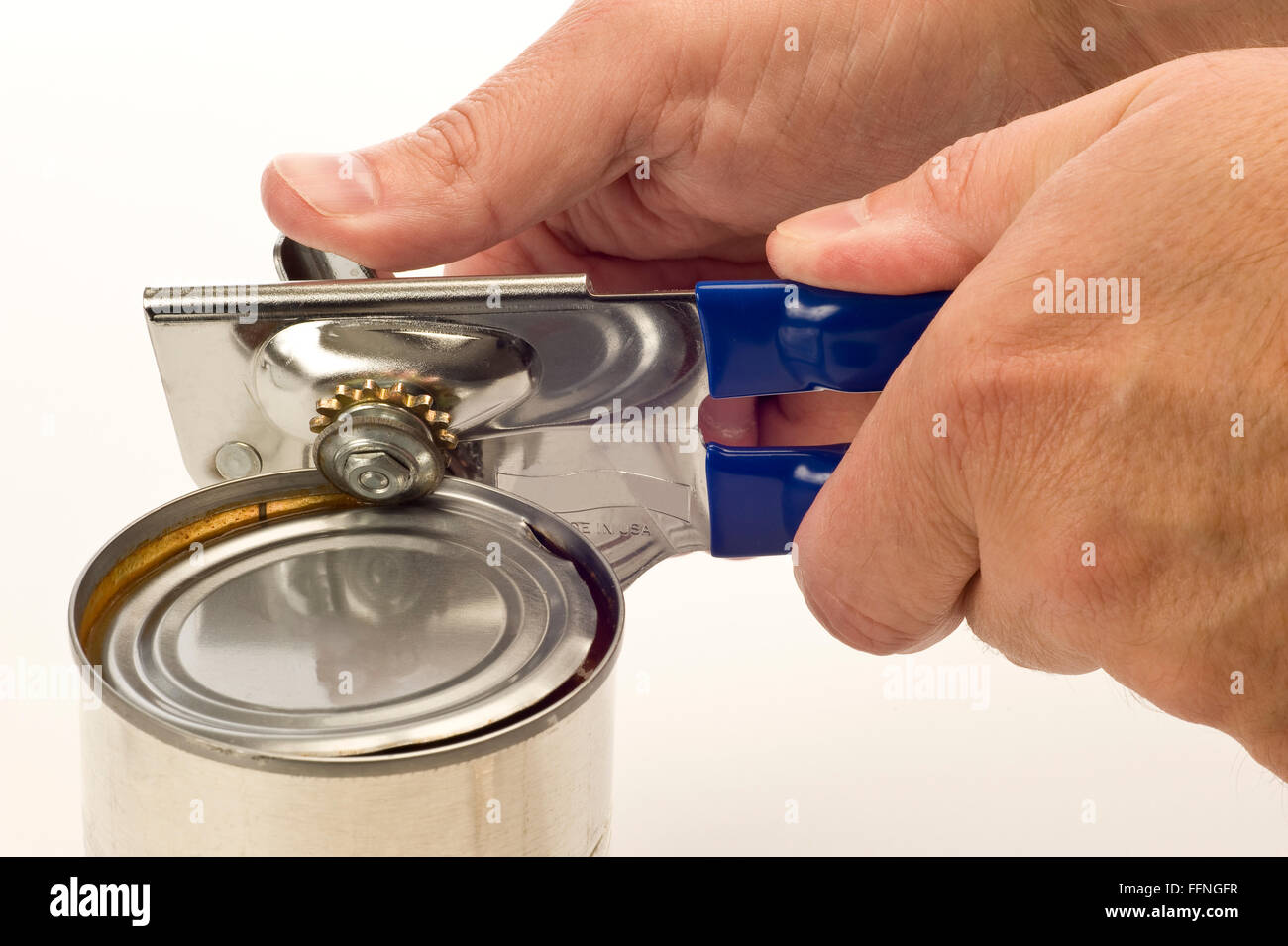 Using Can Opener - Stock Image