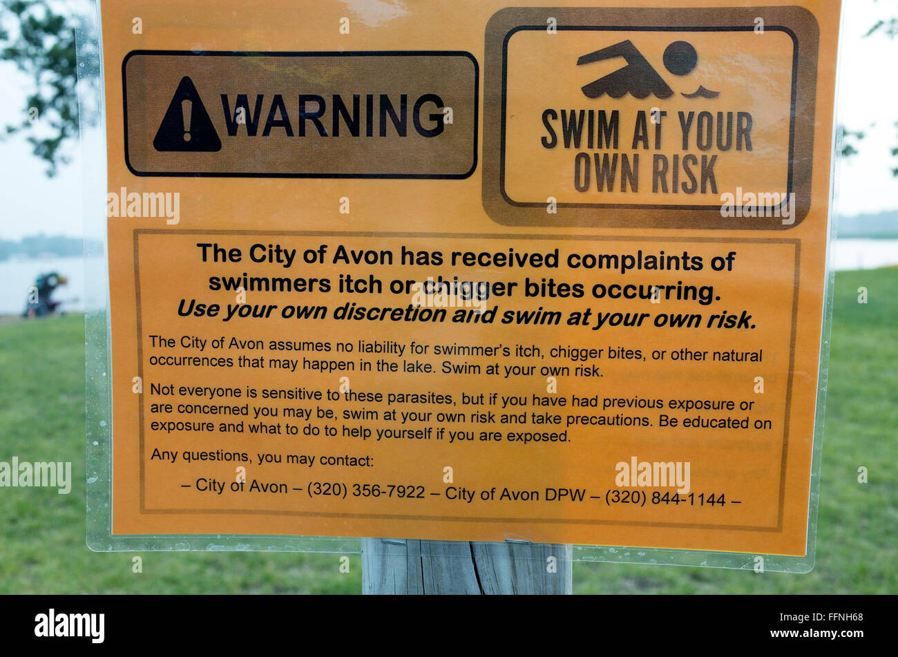 Warning sign for swimmers itch and chigger bites from swimming in Middle Spunk Lake. Avon Minnesota MN USA - Stock Image