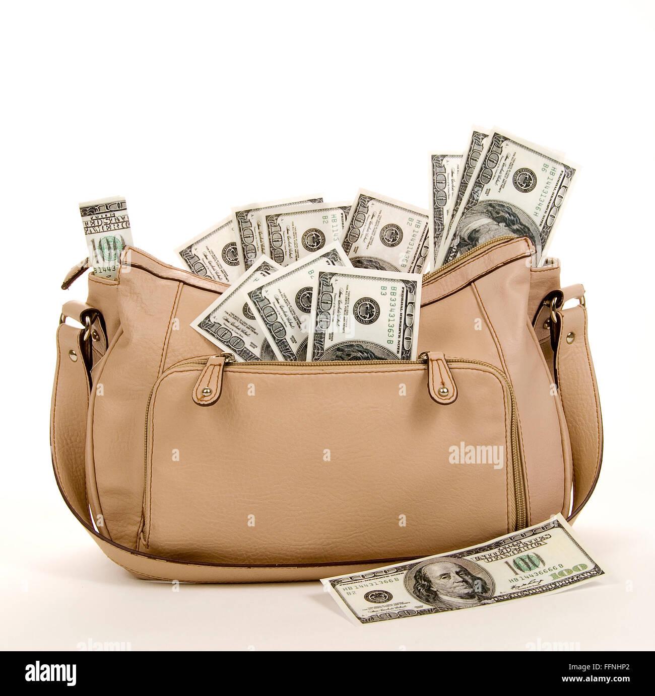 Purse Full of Money - Stock Image