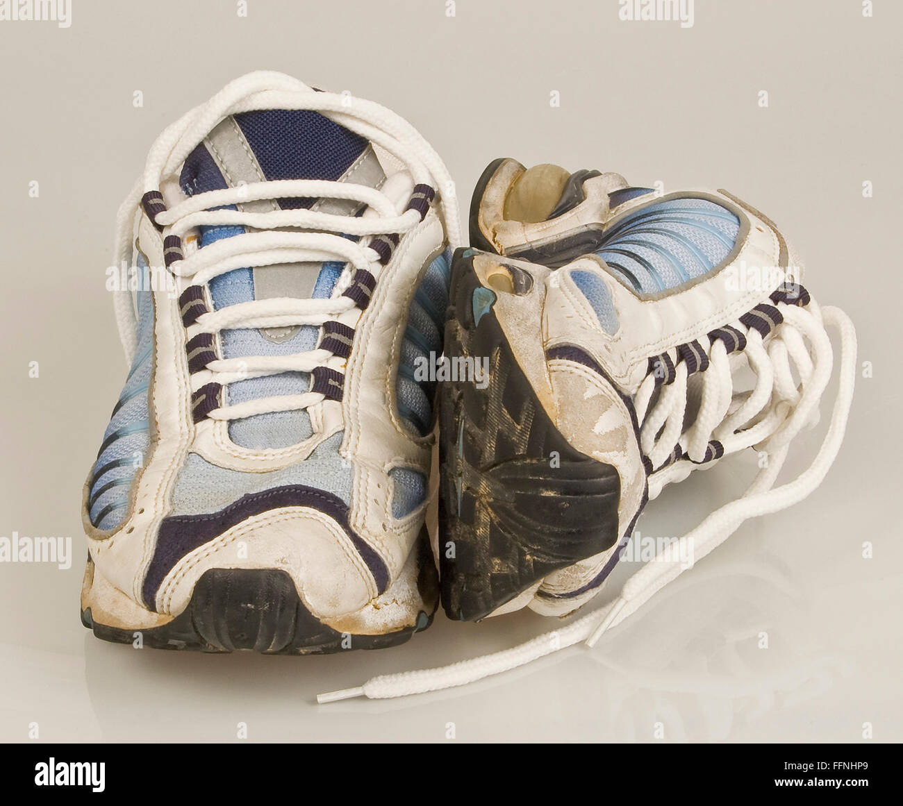 Worn Out Running Shoes - Stock Image