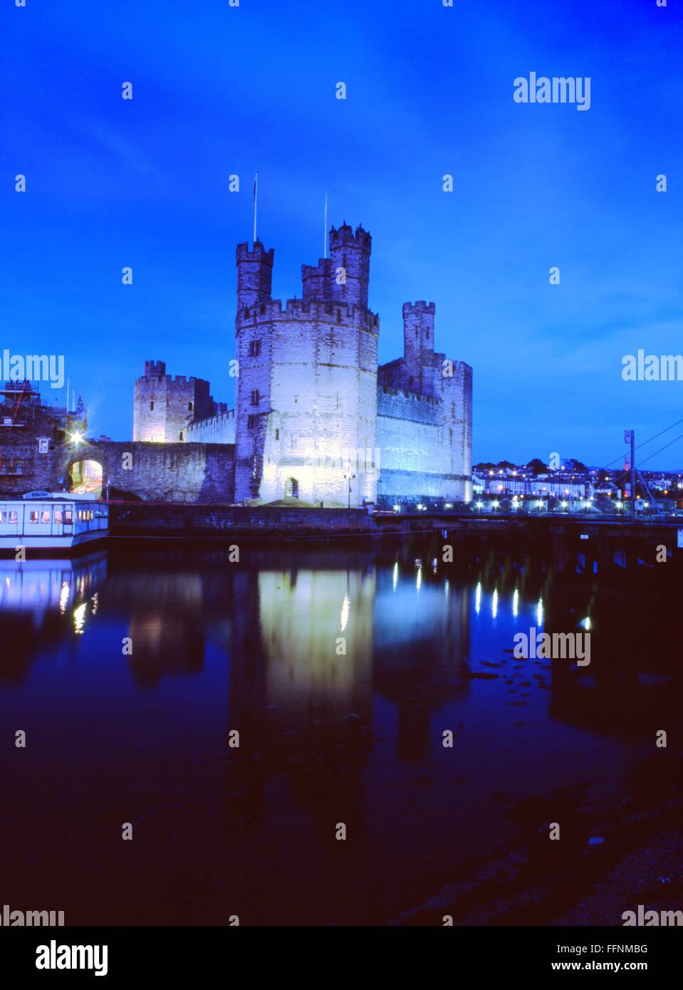 Caernarfon Castle and Seiont estuary at night dusk twilight Gwynedd North Wales UK Stock Photo