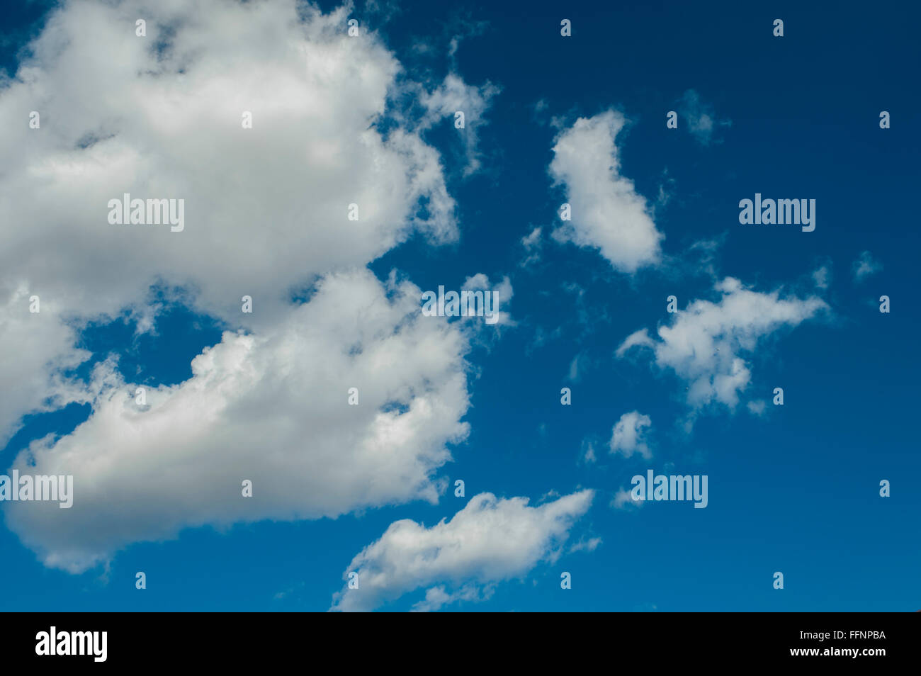 fragment of blue sky with fluffy,patterned clouds - Stock Image