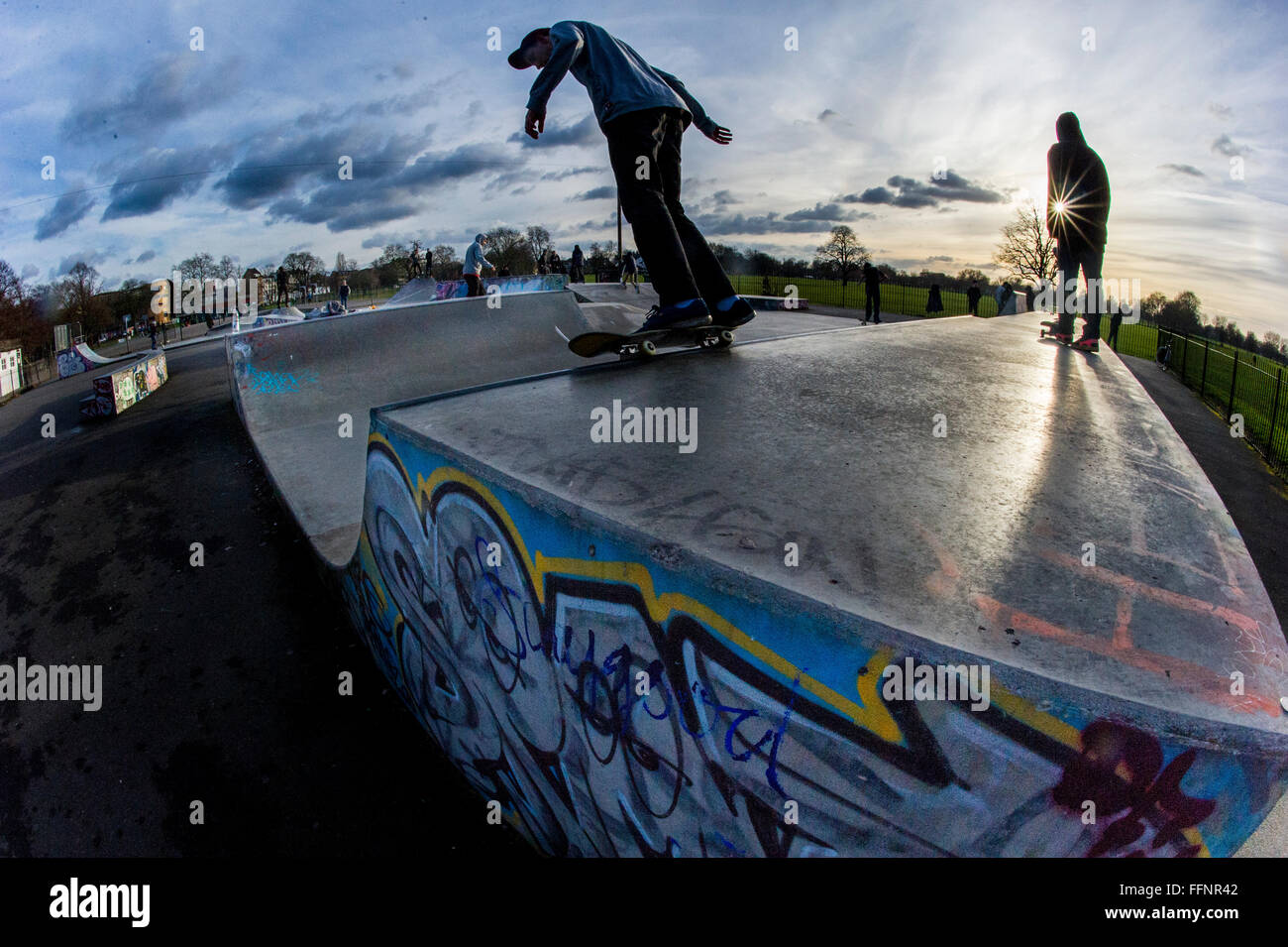 A skateboarder at Clapham Skatepark in South London - Stock Image