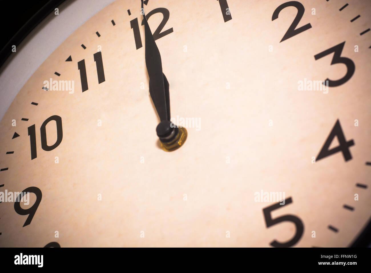 a clock on twelve oclock or midnight - Stock Image