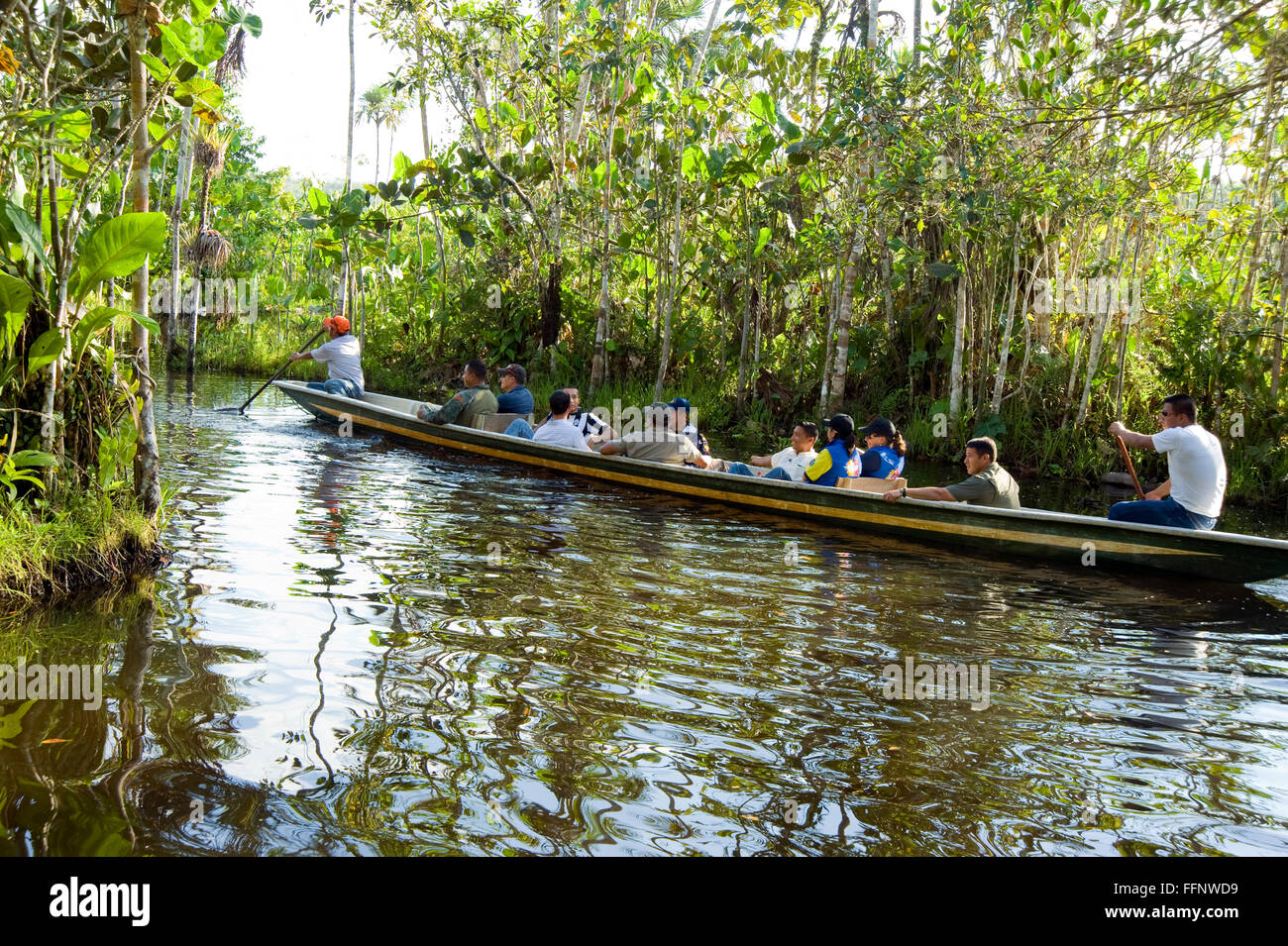 Boat with visitors touring the Amazon River in Ecuador - Stock Image