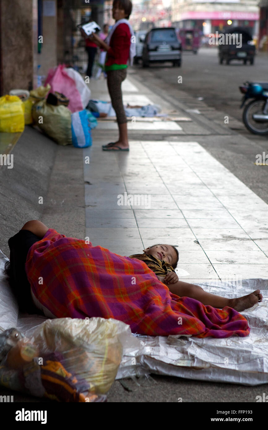 Within Philippine Cities homeless people,which include children & entire families can be seen sleeping on sidewalks. - Stock Image