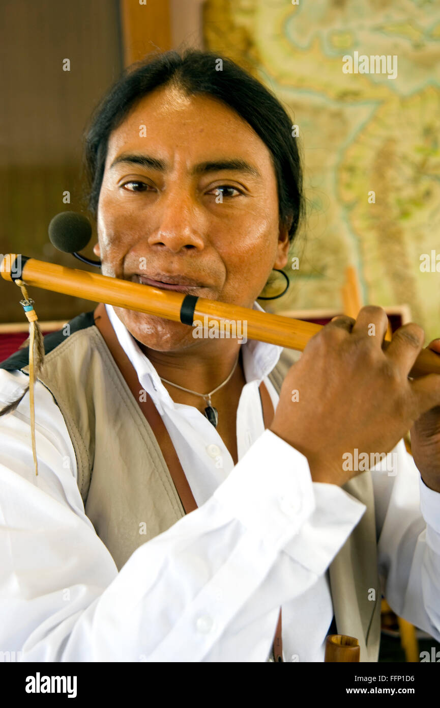 Ecuadoran musician playing a flute - Stock Image