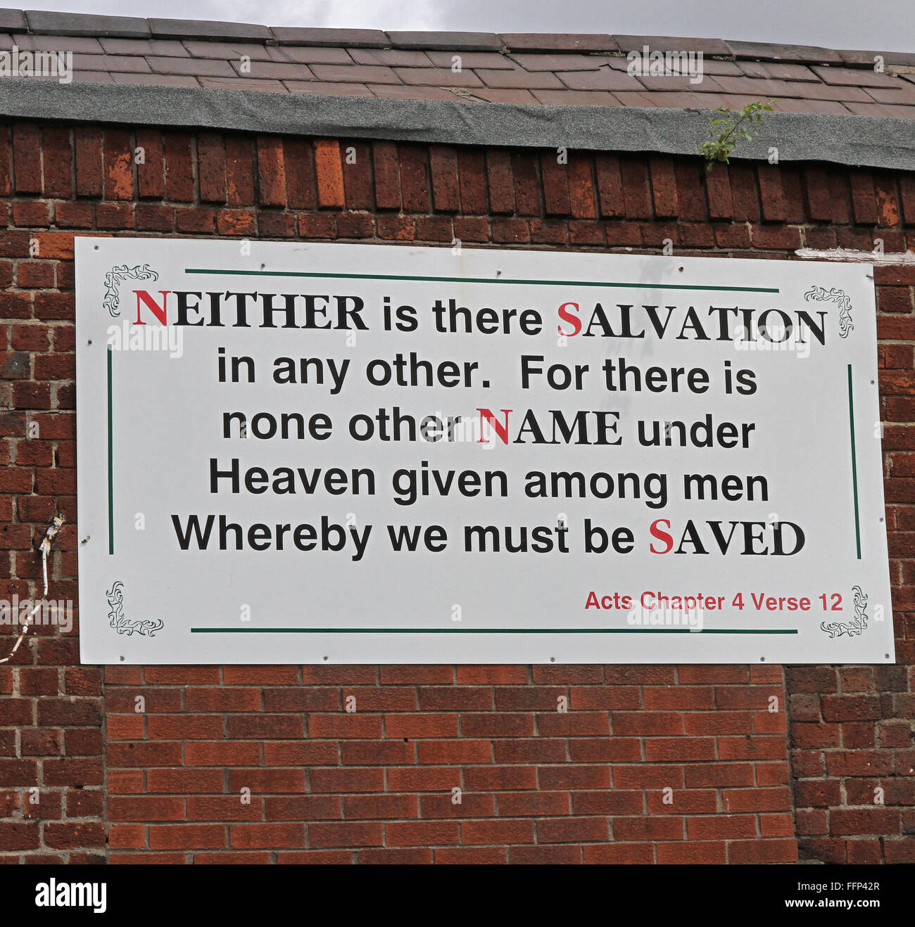 Religious verse on wall in west Belfast. - Stock Image