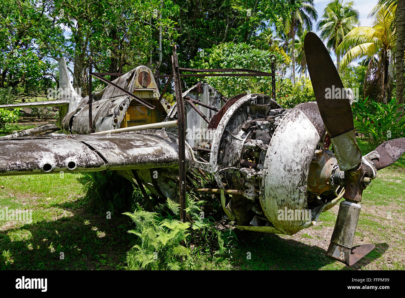 Wreckage of American Grumman Wildcat fighter plane in outdoor Vilu War Museum, Guadalcanal, Solomon Islands. - Stock Image