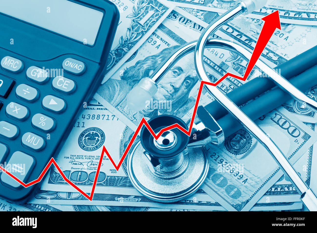 Graph showing the high cost of health care with USD bank notes a stethoscope and calculator - Stock Image
