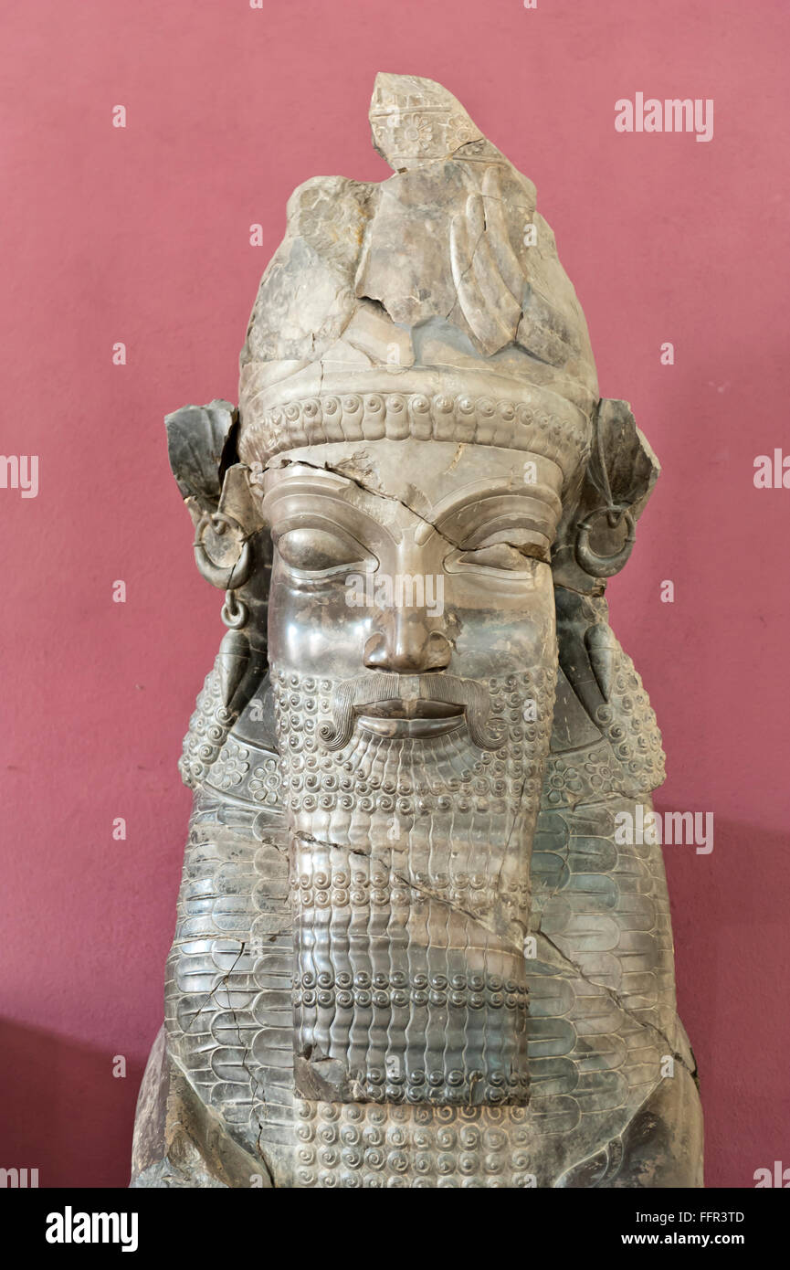 Antique statue of Achaemenids, face with a long beard, Sphinx or Minotaur, found in ancient Persian royal capital - Stock Image