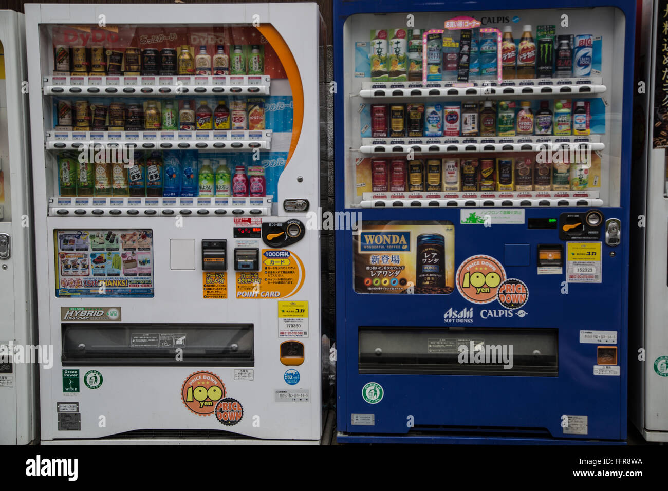 Vending machines in the central neighborhood of Shibuya, Tokyo, in Japan, with colorful beverages and Japanese characters. - Stock Image