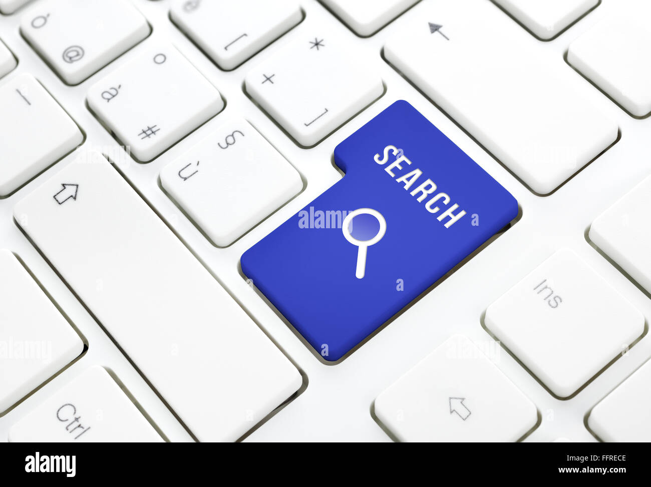 Search business concept, red enter button or key on white keyboard photography. - Stock Image