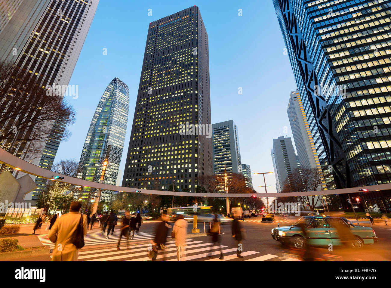 Tokyo, Japan - January 13, 2016: Commuters rushing home after office hours  in Shinjuku, Tokyo - Japan. - Stock Image