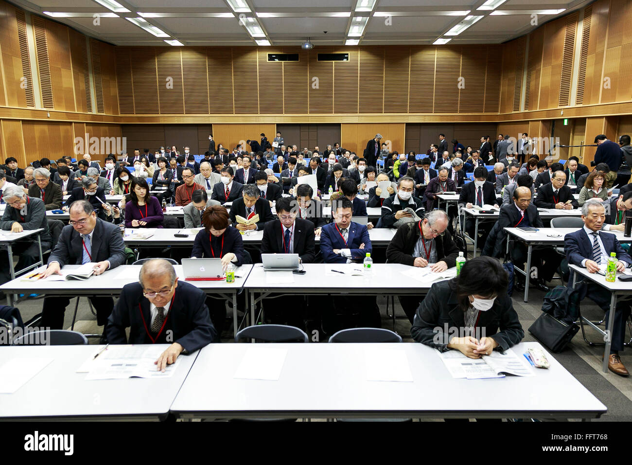 Attendants wait for the explanation of Ryuichi Inagaki, Acting chairman of the Electricity Market Surveillance Commission, - Stock Image