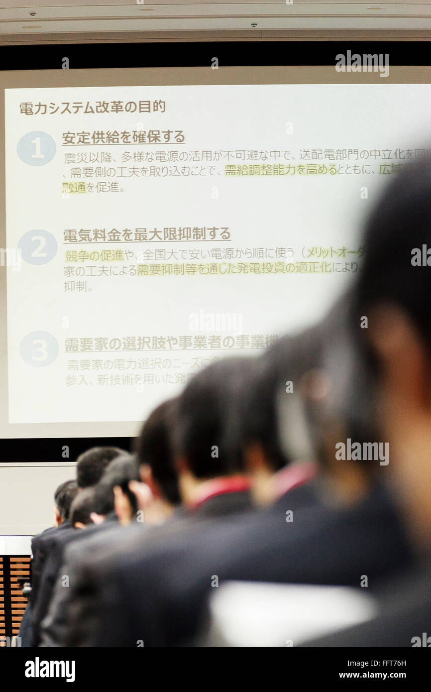Attendants listen the explanation of Ryuichi Inagaki, Acting chairman of the Electricity Market Surveillance Commission, - Stock Image