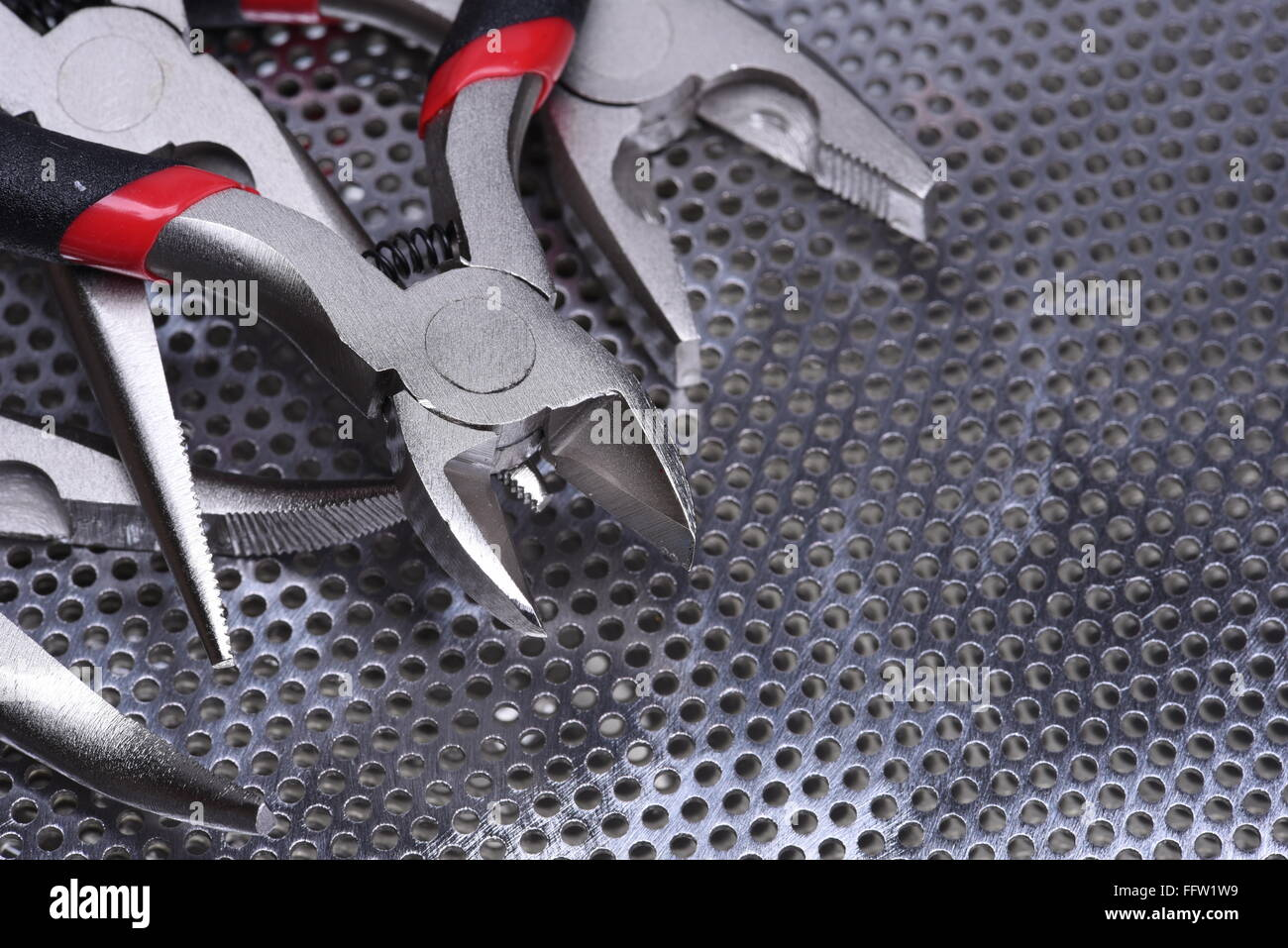 Electrical tools wire cutter, pliers on metal background Stock Photo ...