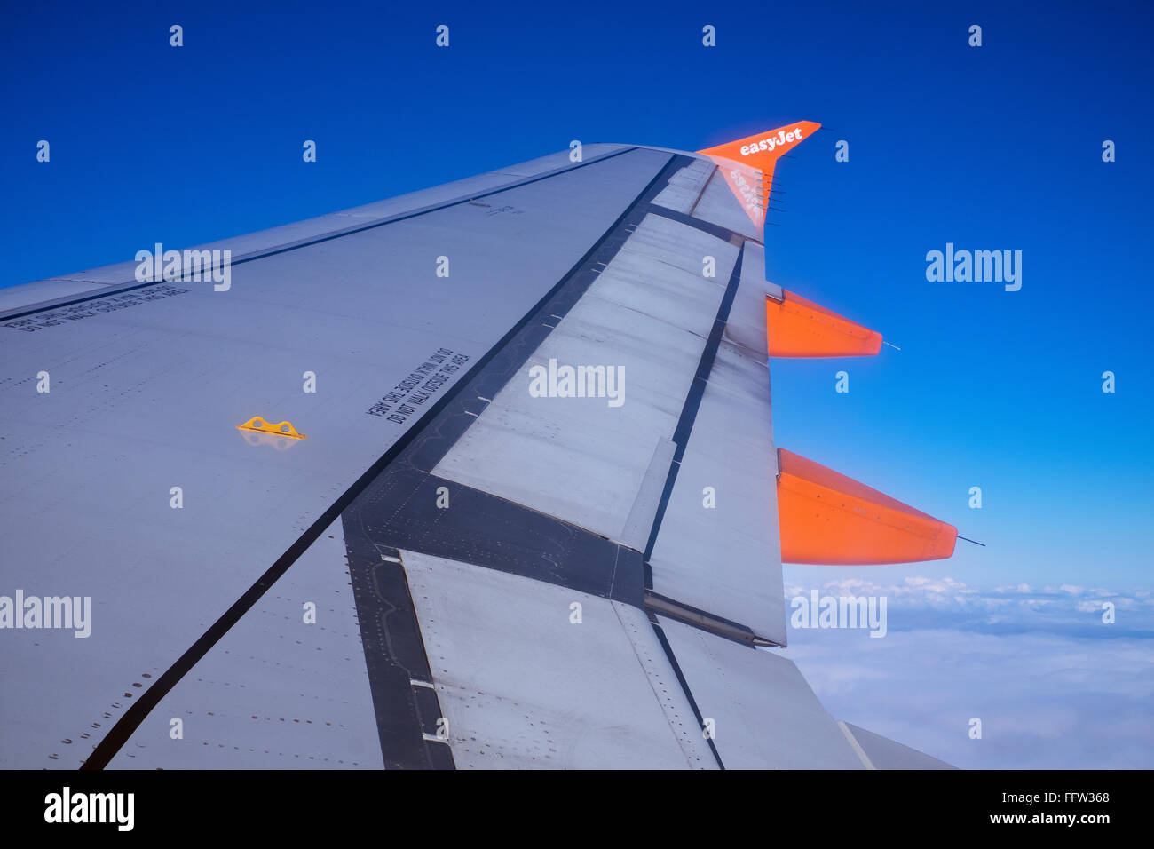 View of wing tip of Easyjet plane in flight - Stock Image