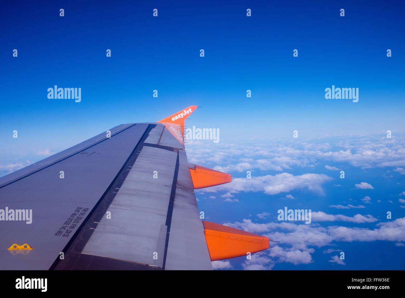 Easyjet wing tip in flight over the Netherlands - Stock Image