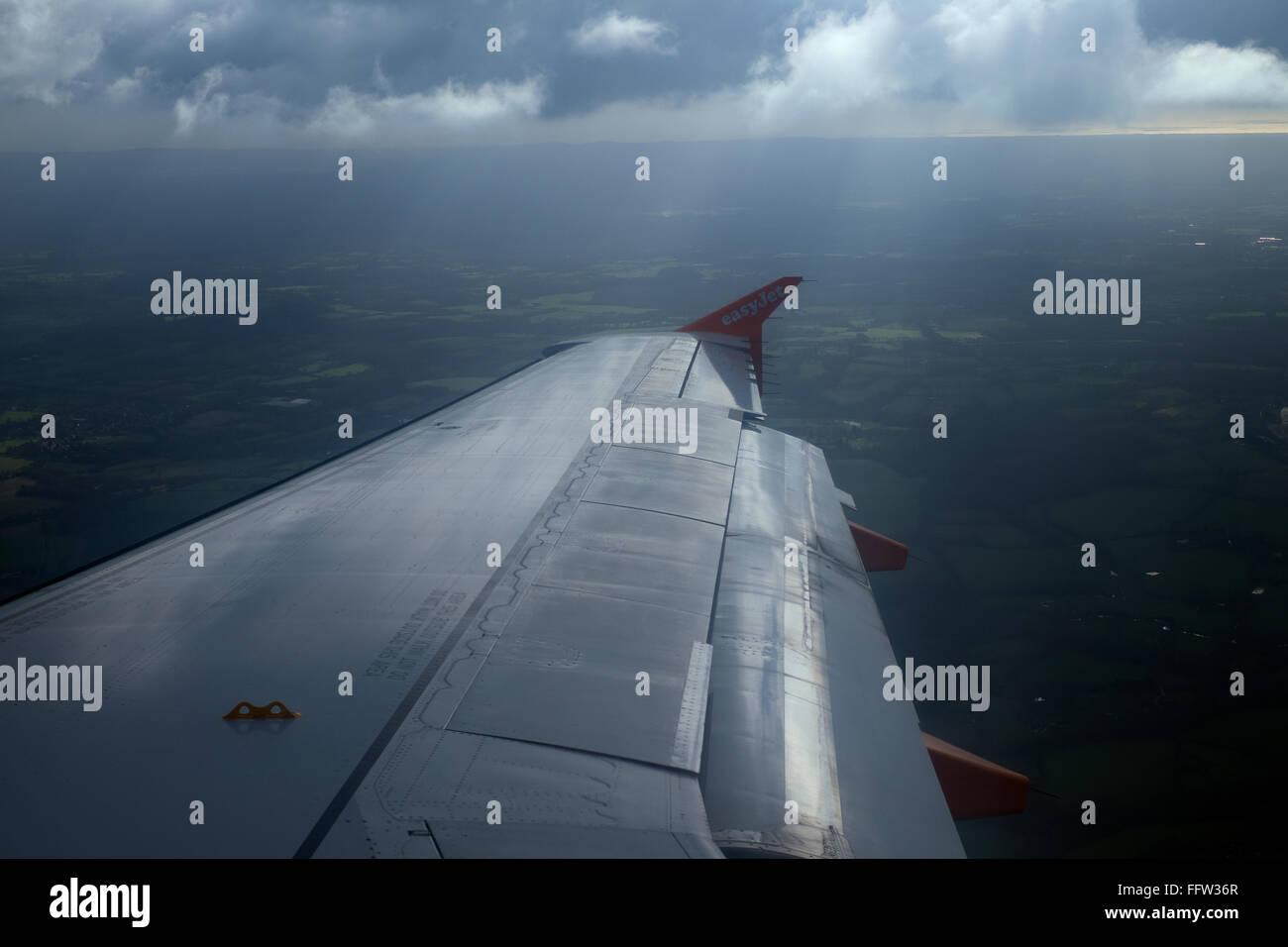 Easyjet plane in flight over the Netherlands - Stock Image