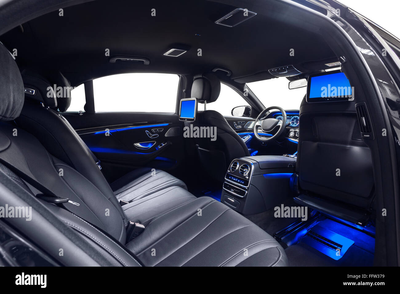 Car Interior Luxury. Comfortable Modern Black Salon With Multimedia U0026 Blue  Ambient Light. Cleaning And Detailing Car Service.