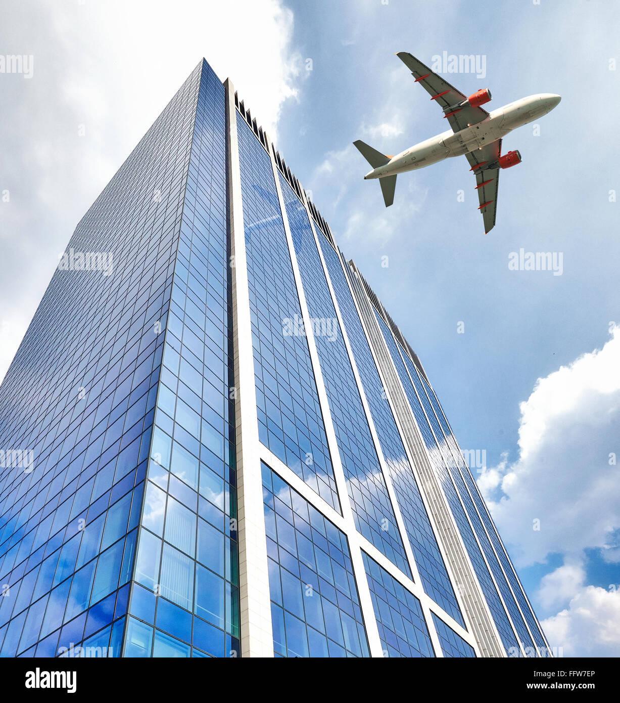 Plane Over Building Stock Photos & Plane Over Building