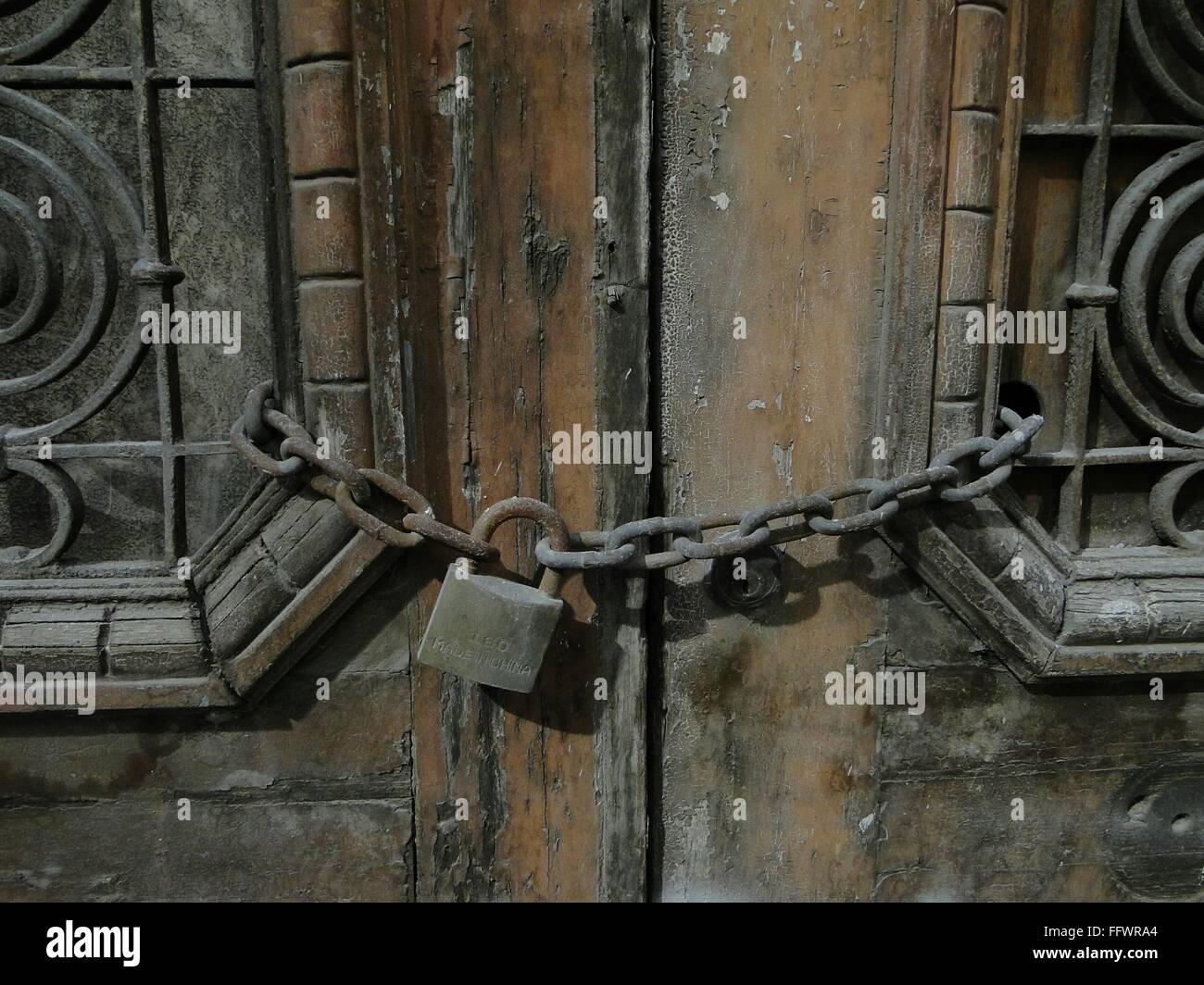 Rusty Chain Lock On Old Wooden Door Stock Photo