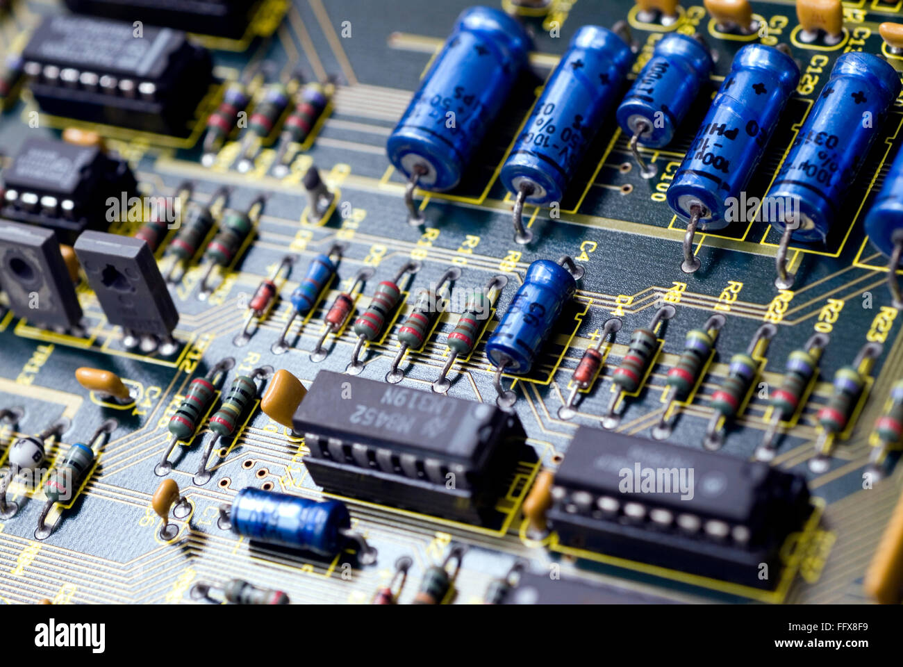 Electronic printed circuit board capacitors resistors IC - Stock Image