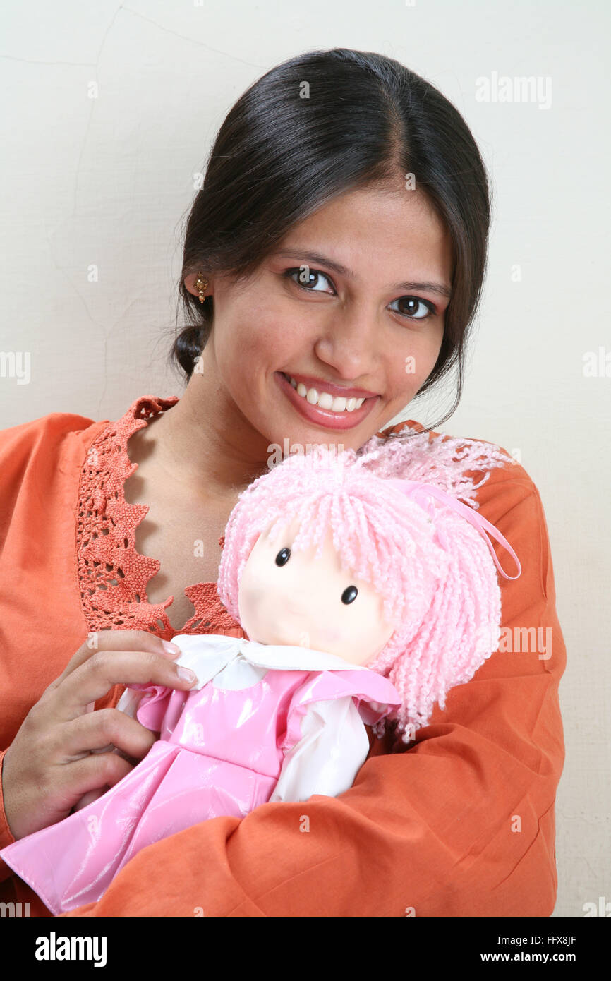 b9aacac392e South Asian Indian young pregnant lady holding a baby doll and smiling  MR 687 Q