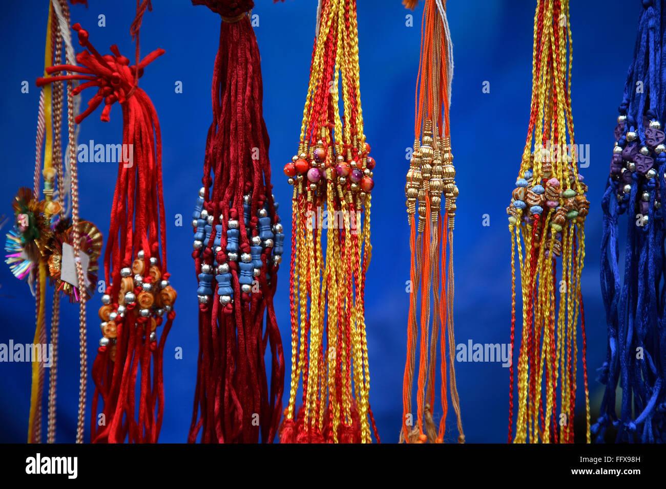Rakhis , silk thread tied by sister to brother on Raksha Bandhan day , Colorful Rakhis for sale , India - Stock Image