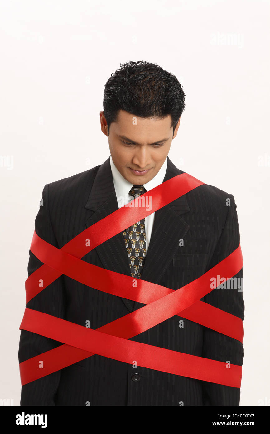 Businessman tied with red ribbon MR#703T Stock Photo