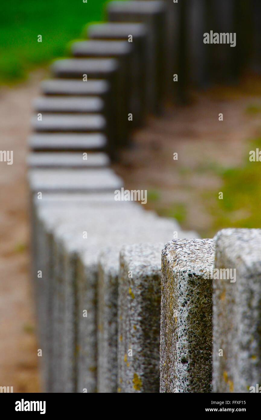 Close-Up Of Concrete Poles - Stock Image