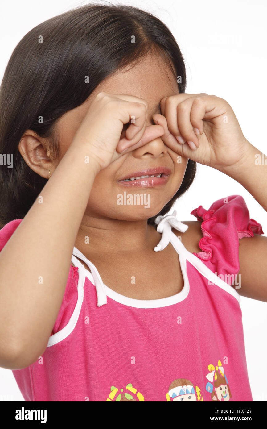 Eight year old girl crying and rubbing eyes with hands MR#703U Stock Photo