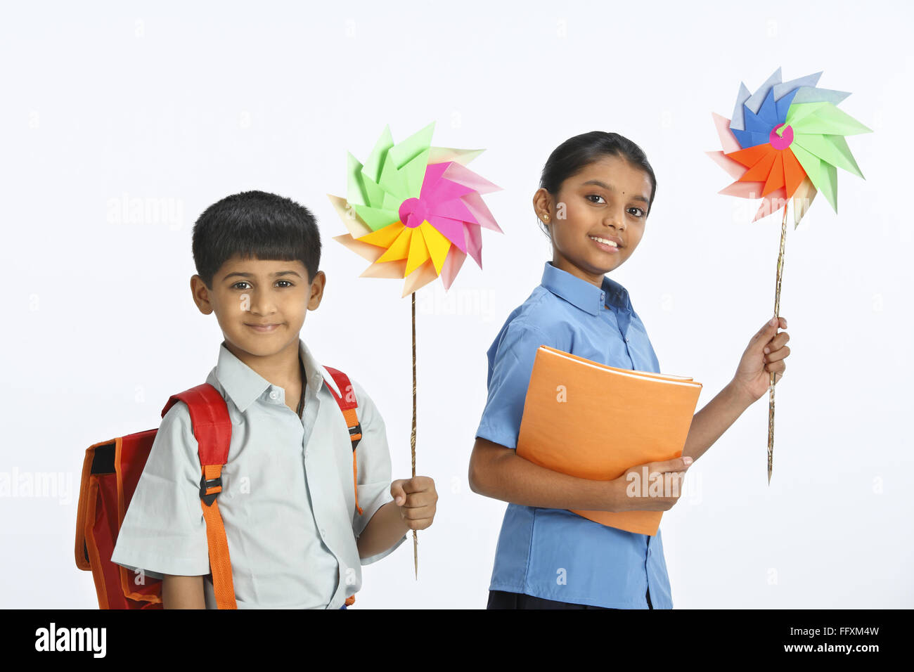 Rural boy and girl holding whirligig in left hands MR#743C,743D - Stock Image