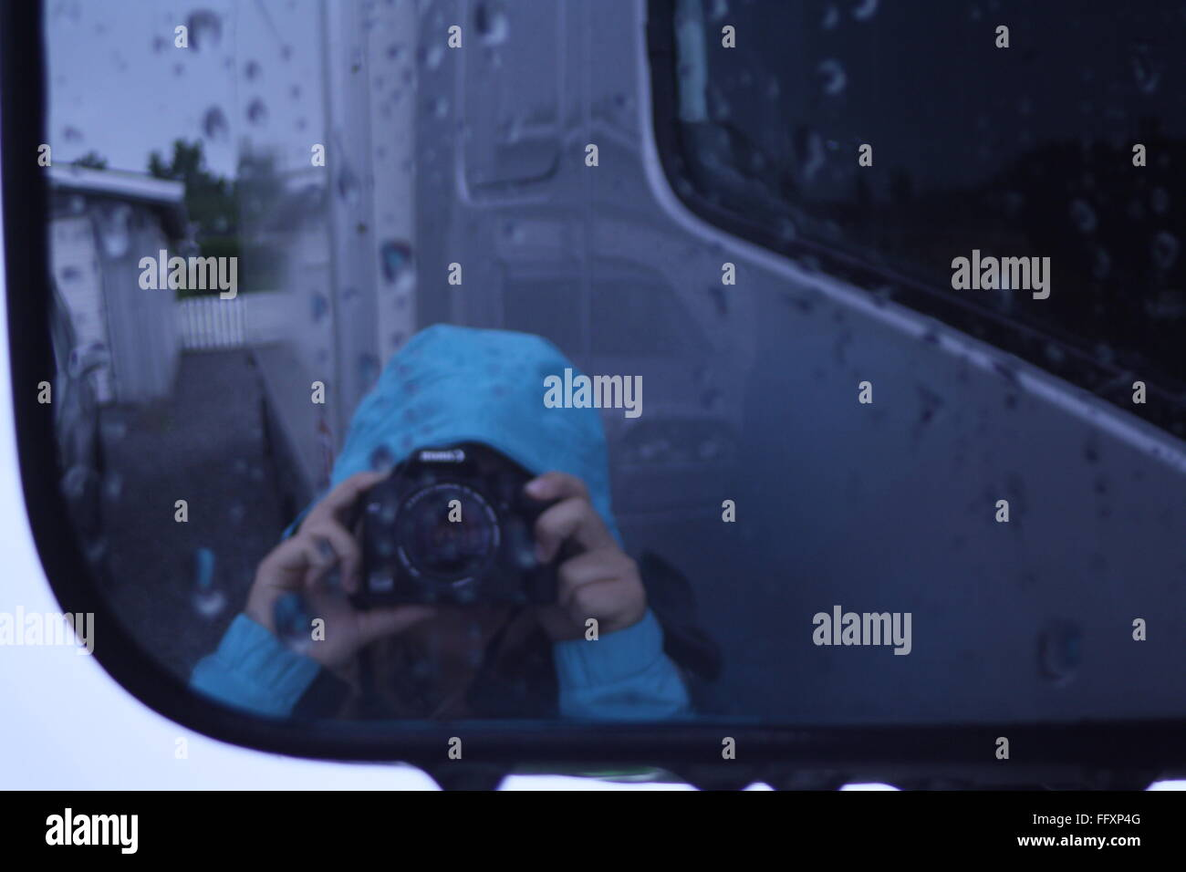 Photographing in the rain - Stock Image