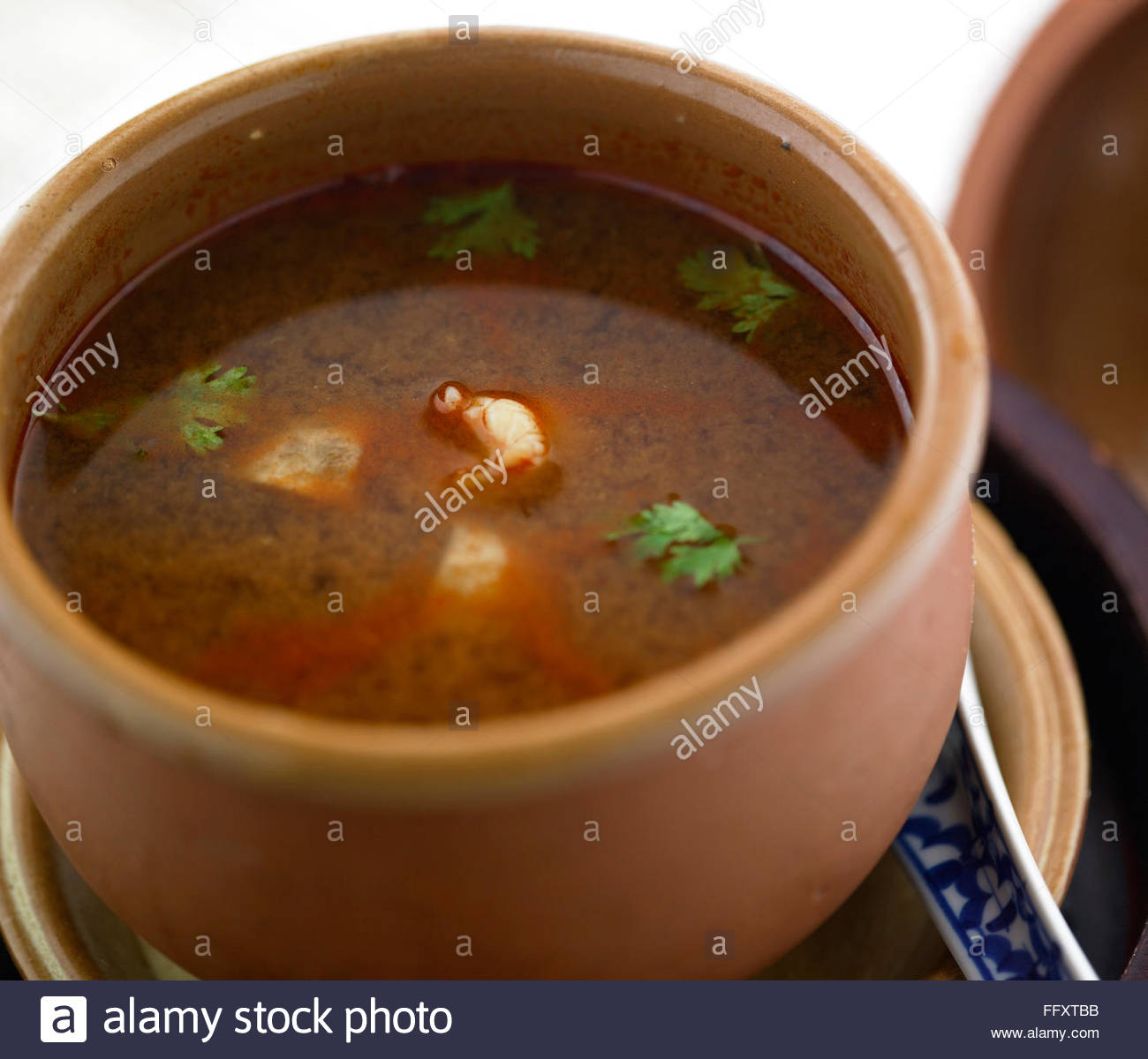 Non vegetarian meal , prawns tom yum soup served in bowl - Stock Image