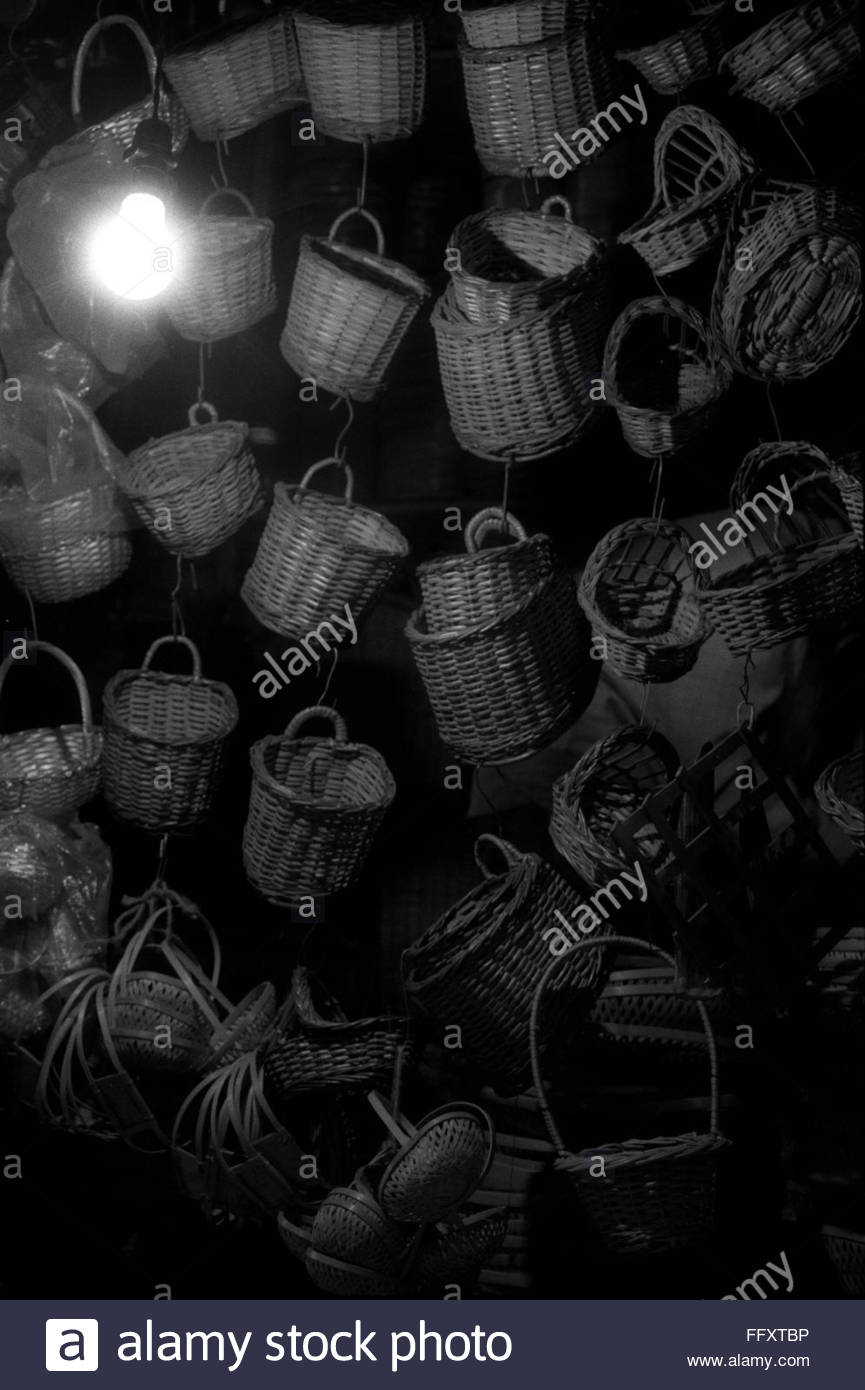 35mm scanned assorted cane baskets hanging - Stock Image