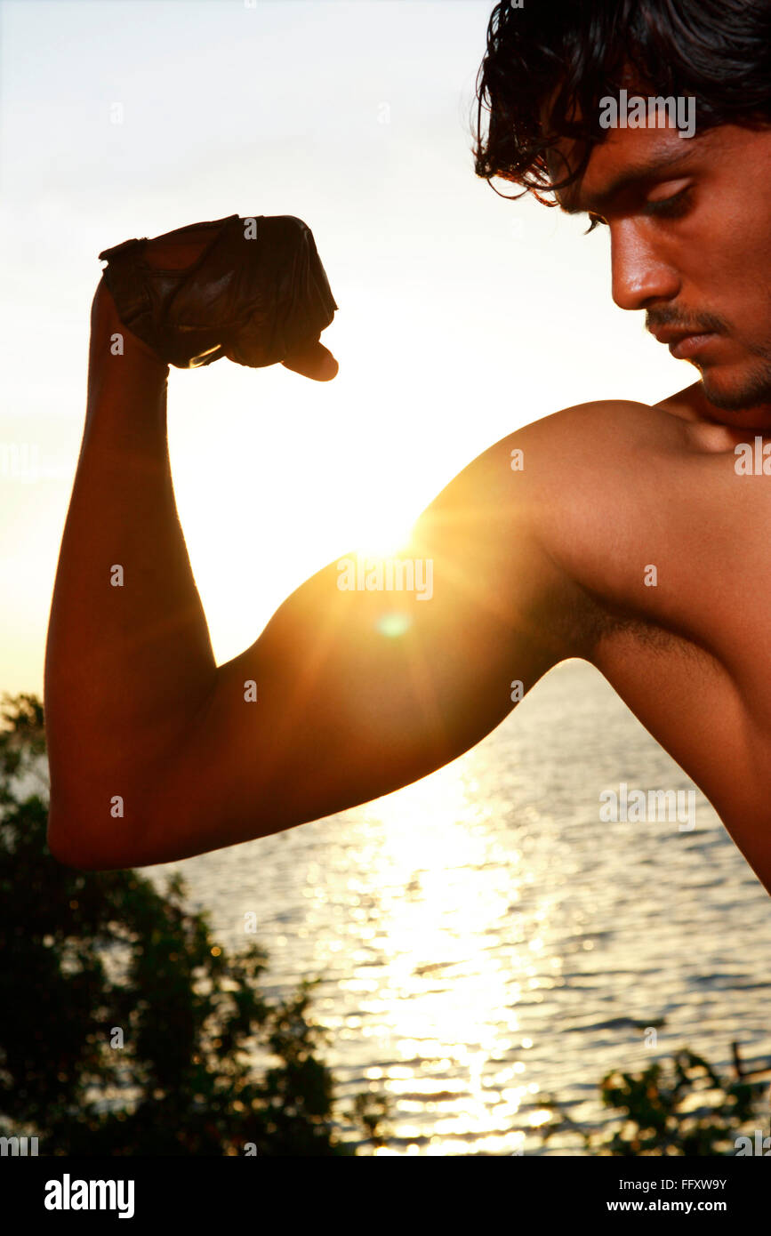 Boy looking at muscles MR#761B Stock Photo