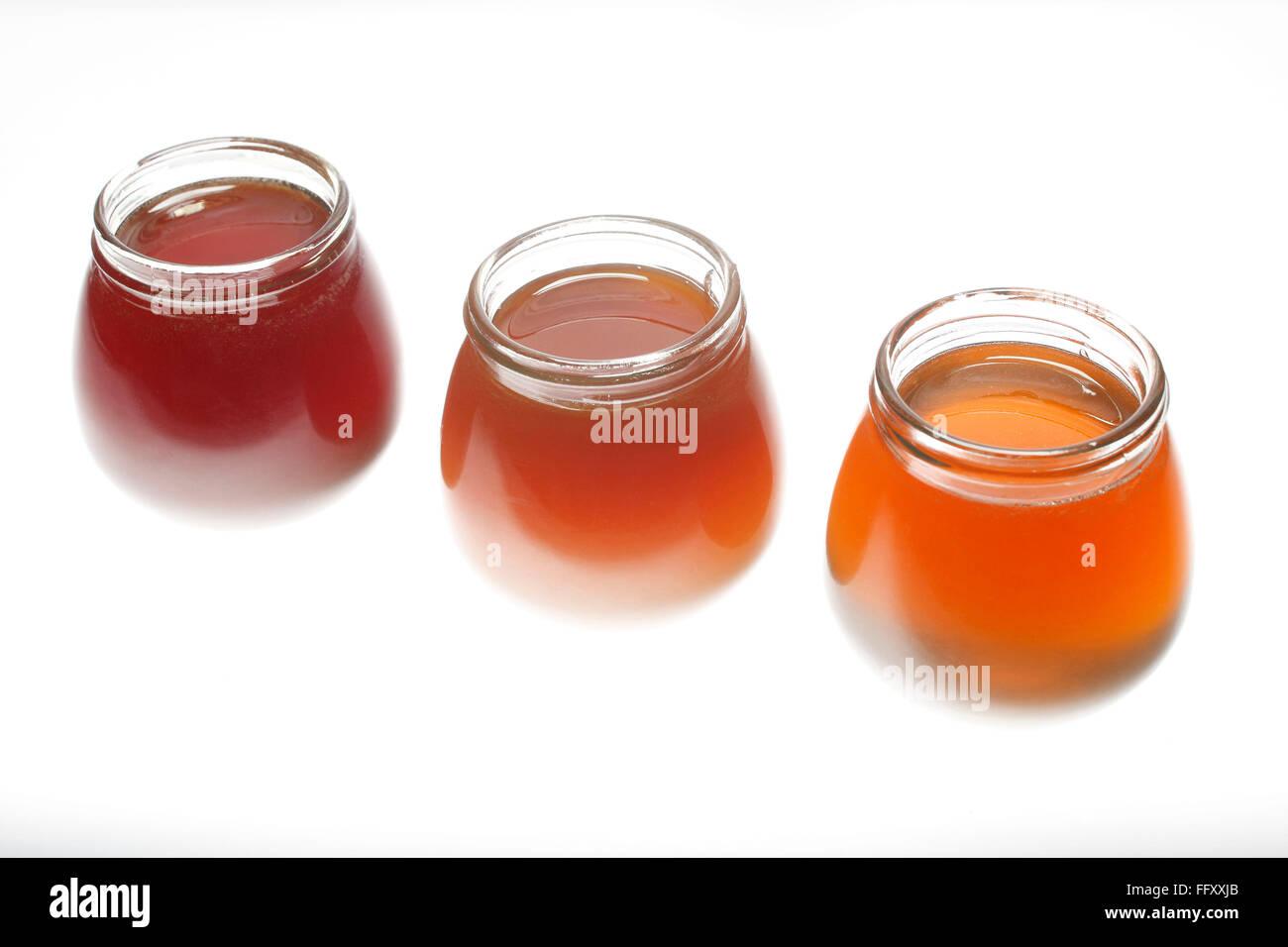 Food , honey of three flavour orange blossom till & bajra in bottles - Stock Image