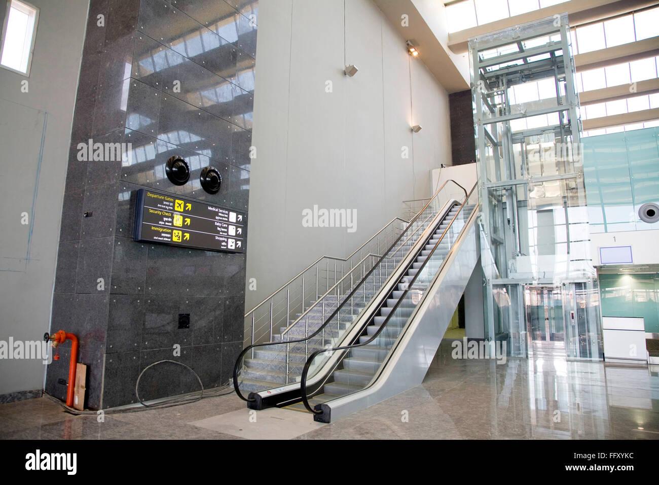 Elevator step check counters going towards final security check Bengaluru international airport Bangalore Karnataka - Stock Image