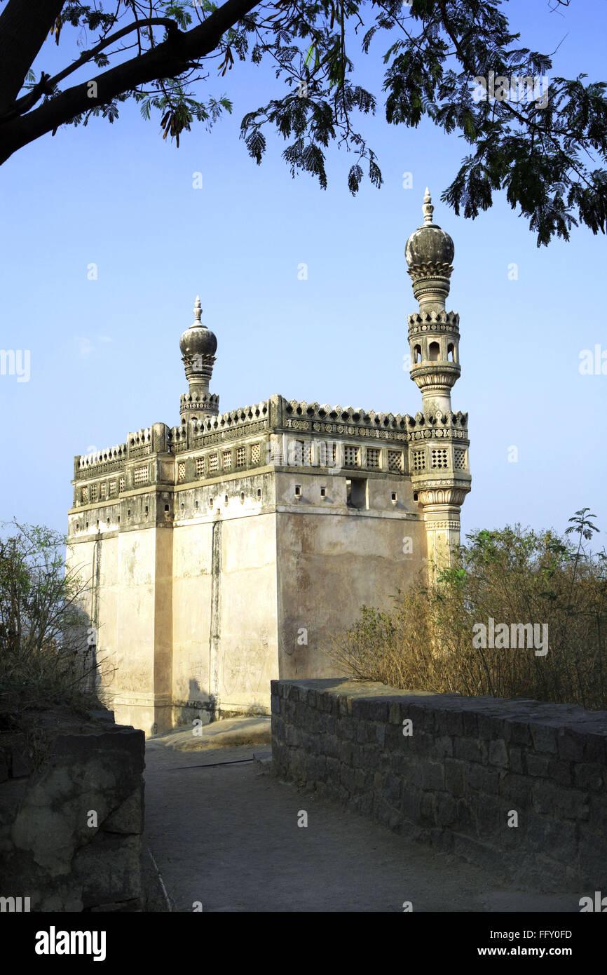 Masjid on hillock with minarets of mogul architectures inside Golconda , Hyderabad , Andhra Pradesh , India - Stock Image