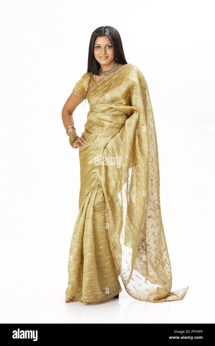 Indian lady standing in stylish pose wearing ceremonial silk sari MR#738 - Stock Image