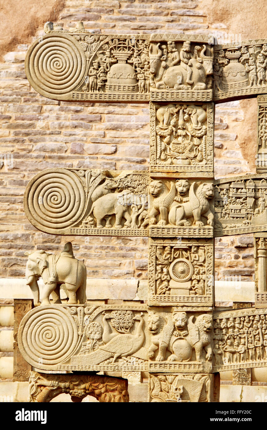 Details of south pillar of eastern gateway with three pales showing stories Buddha stupa No 1 Sanchi Bhopal Madhya Stock Photo