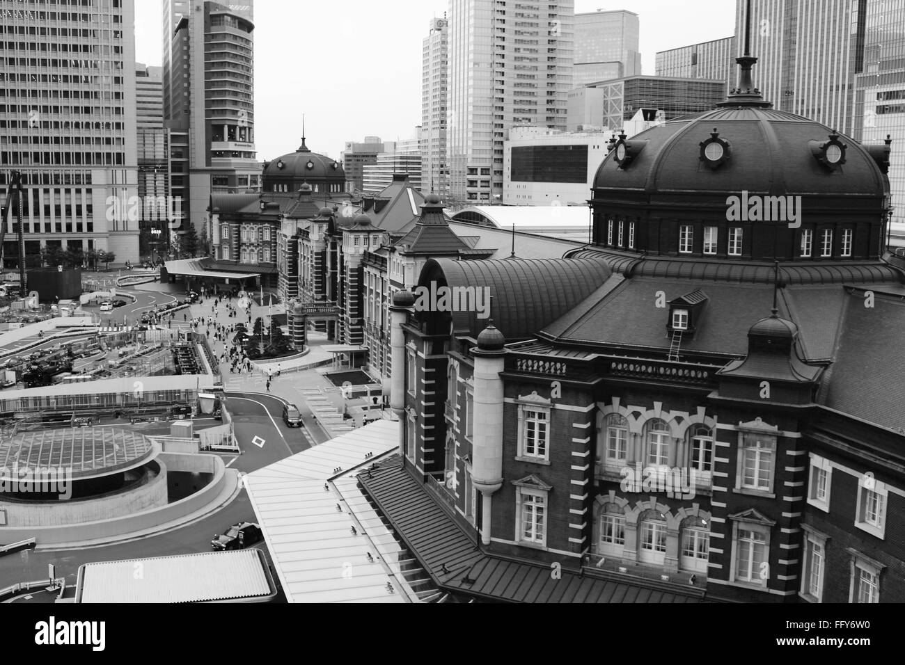 Tokyo Station Amidst Buildings In City - Stock Image
