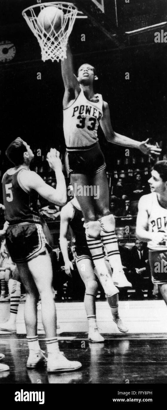 KAREEM ABDUL JABBAR (1947- ). /nNΘ Ferdinand Lewis Alcindor. American basketball player. Photographed dunking aStock Photo