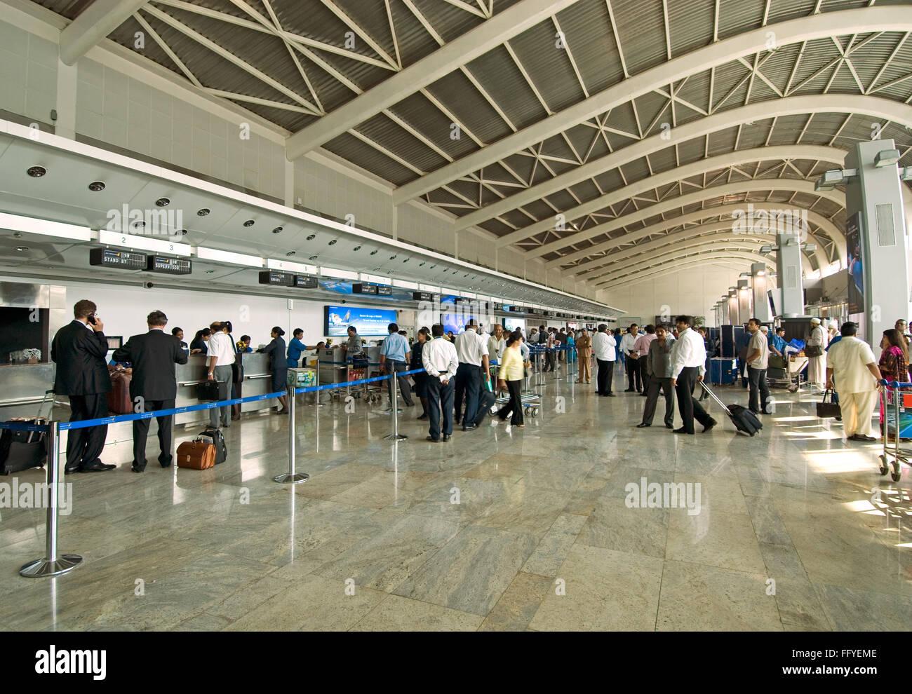 Check in counters at chhatrapati shivaji international airport ; Santacruz ; Bombay Mumbai ; Maharashtra ; India - Stock Image